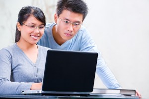 bigstock_Couple_Browsing_Internet_At_Ho_5100194